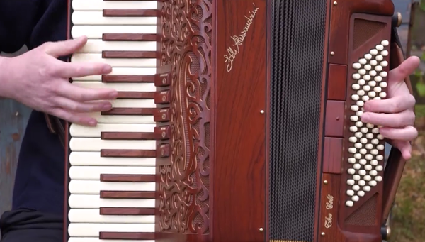 Photo: Still from video -- Close-up of piano keys and bellows on Alessandrini Celt.