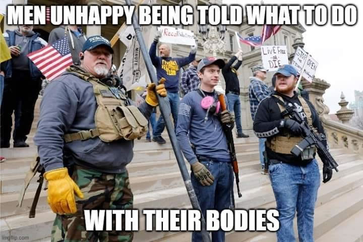 "Photo: Armed militia men on the steps of a government building, with the caption ""Men unhappy being told what to do with their bodies"""