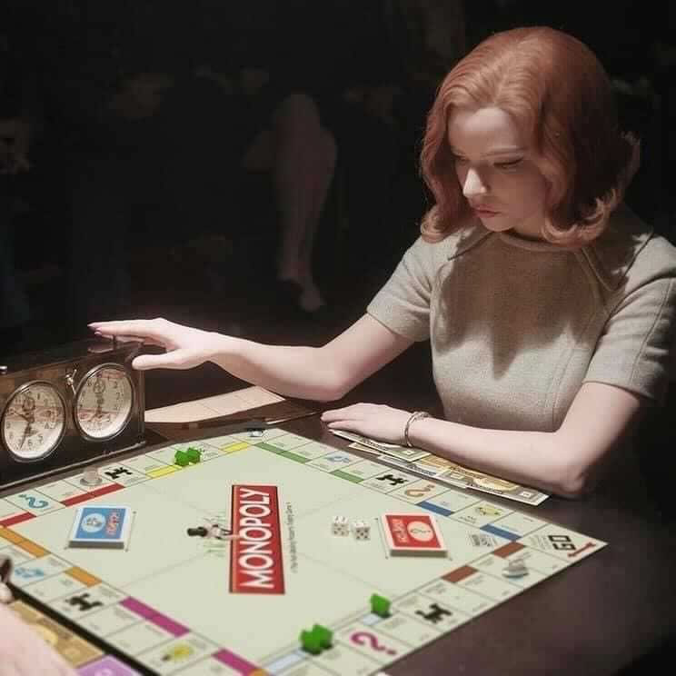 """Photo: """"Beth"""" from """"The Queen's Gambit"""" playing Monopoly instead of chess."""