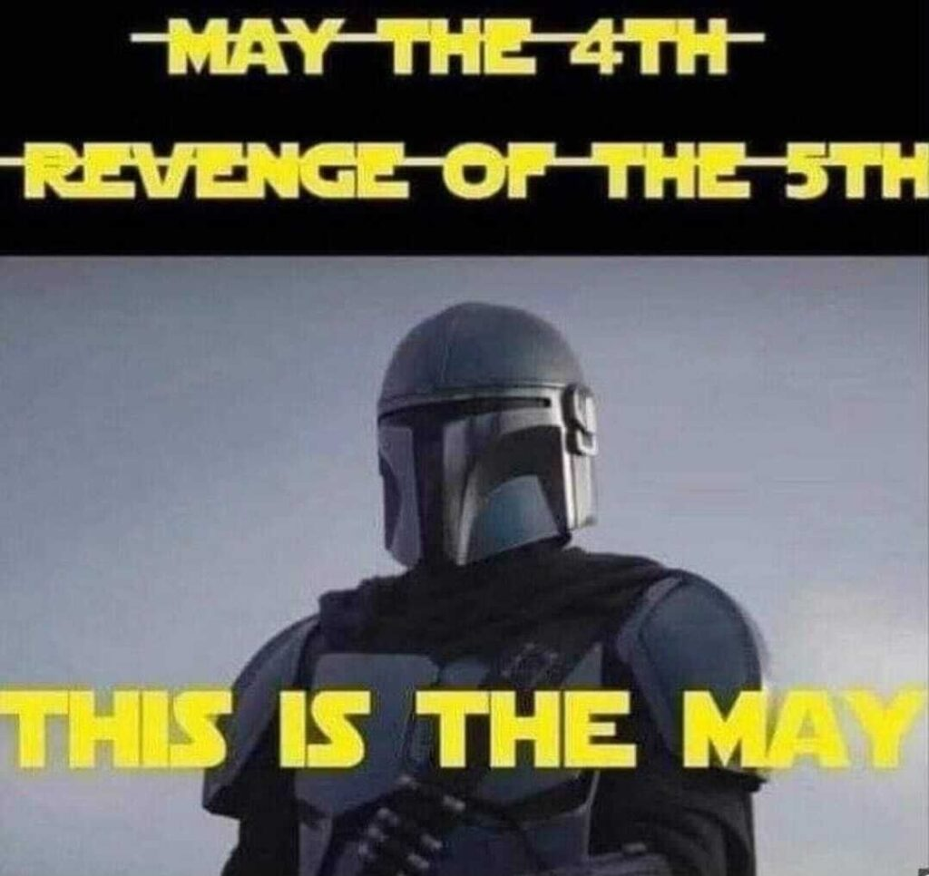 "Picture of Din Djarin (""The Mandalorian"") with the struck-out headings ""May the 4th"" and ""Revenge of the 5th"", and below them, the final heading: ""THIS IS THE MAY"""
