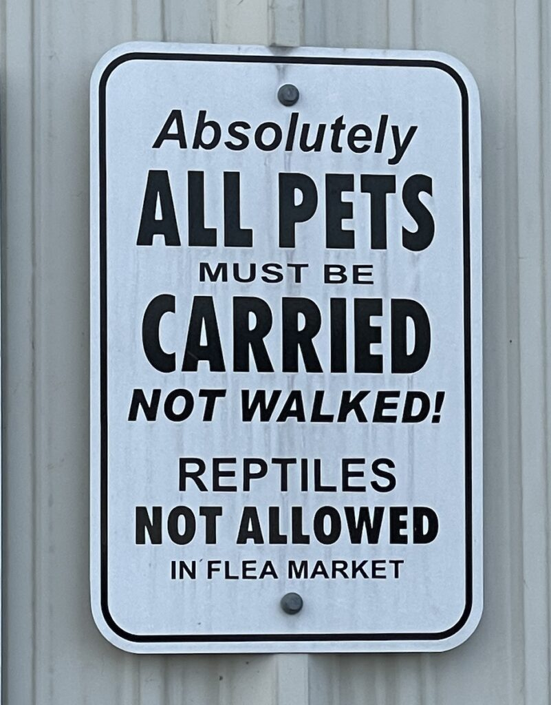 """Sign: """"Absolutely ALL PETS must be CARRIED not walked! Reptiles NOT ALLOWED in flea market"""""""""""